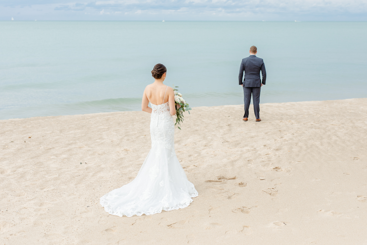 Bride and groom on beach of the lakehouse wedding