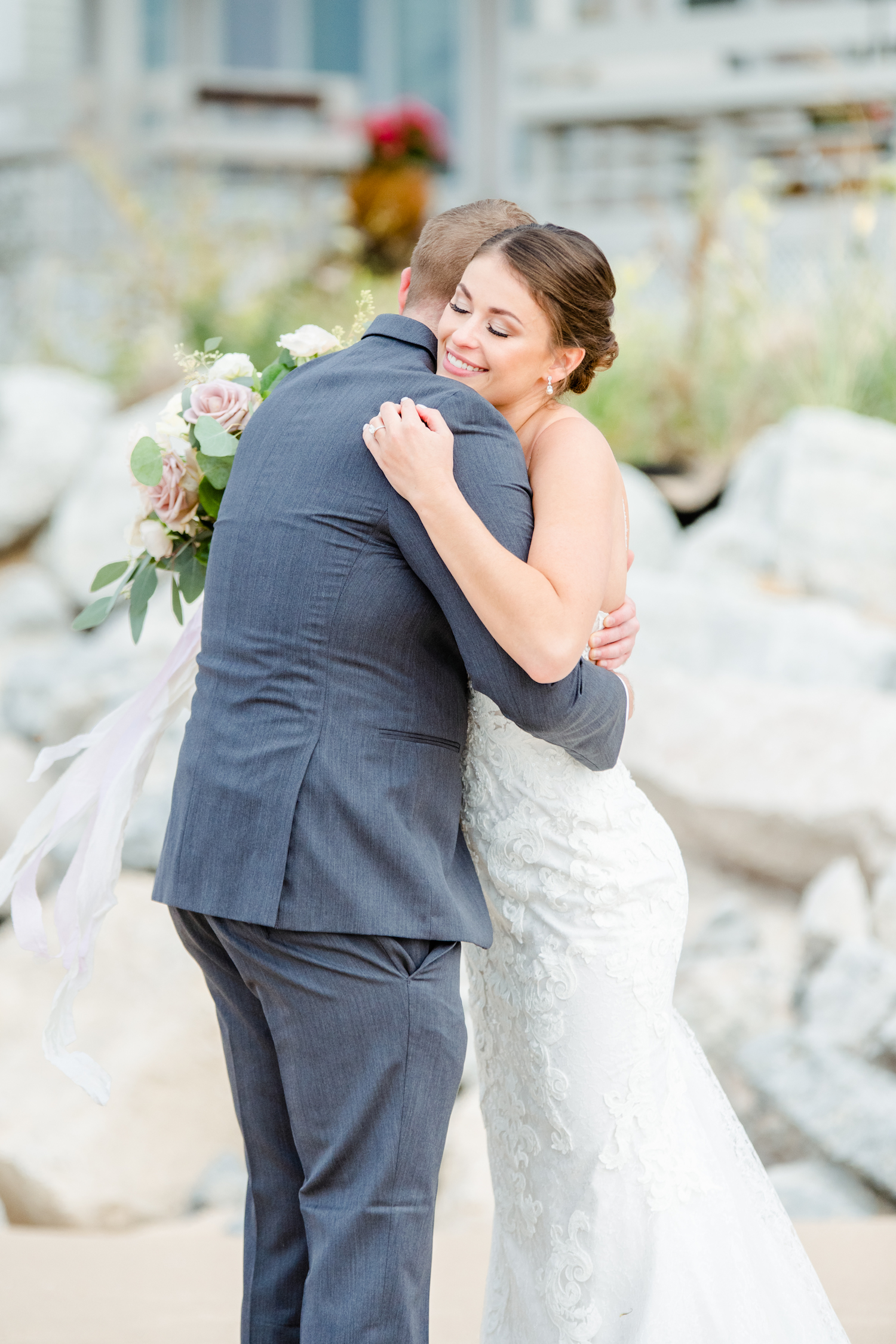 Bride and Groom hugging at their lakehouse wedding