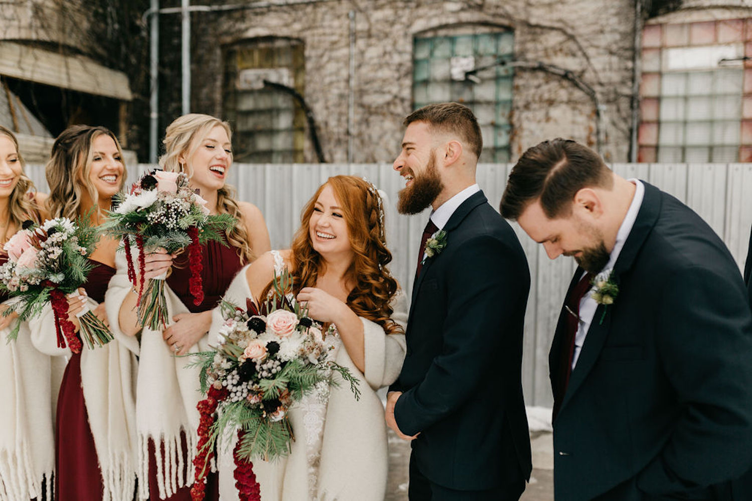 Bridal party laughing at Journeyman Distillery wedding