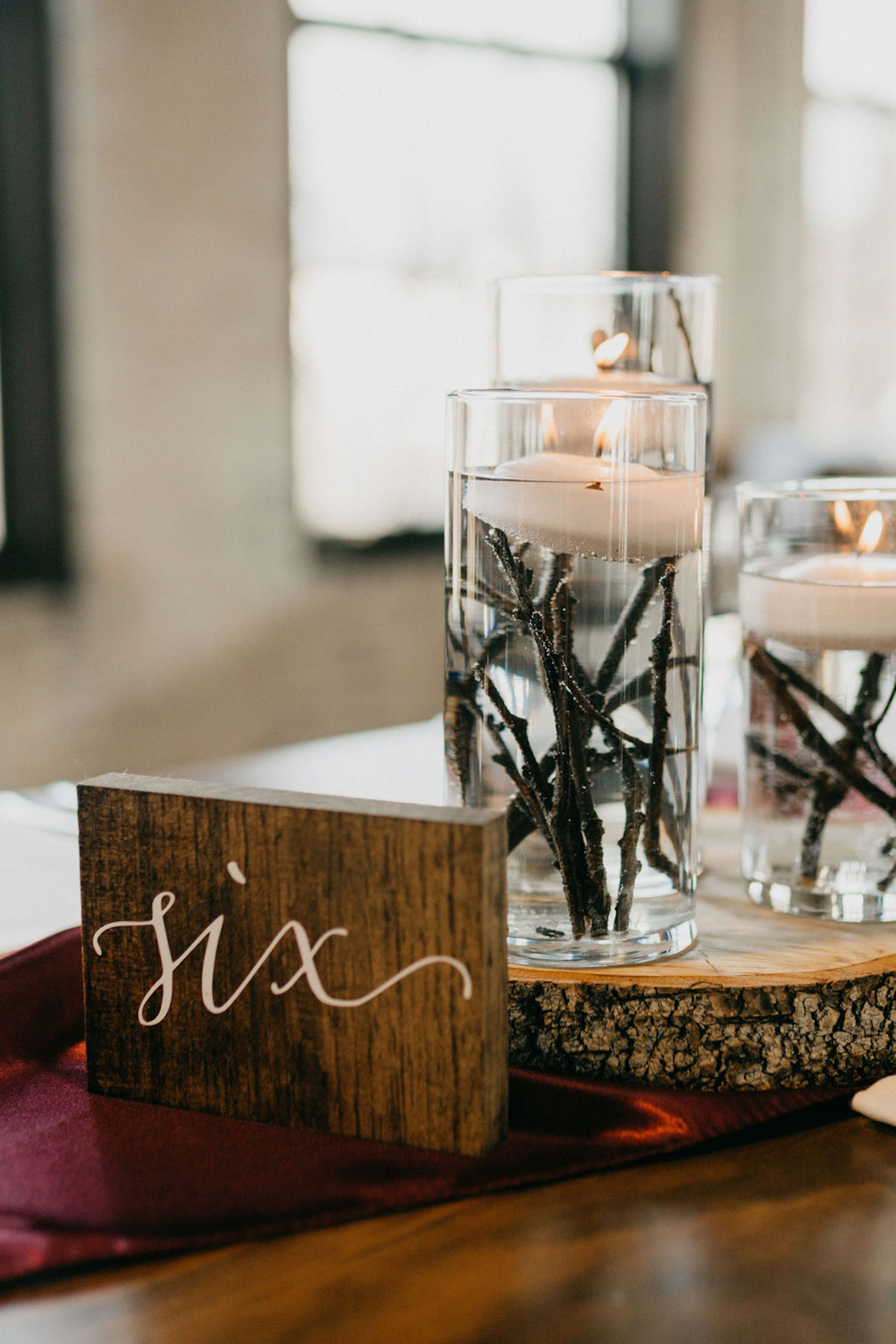 Table number and decor for Journeyman Distillery wedding