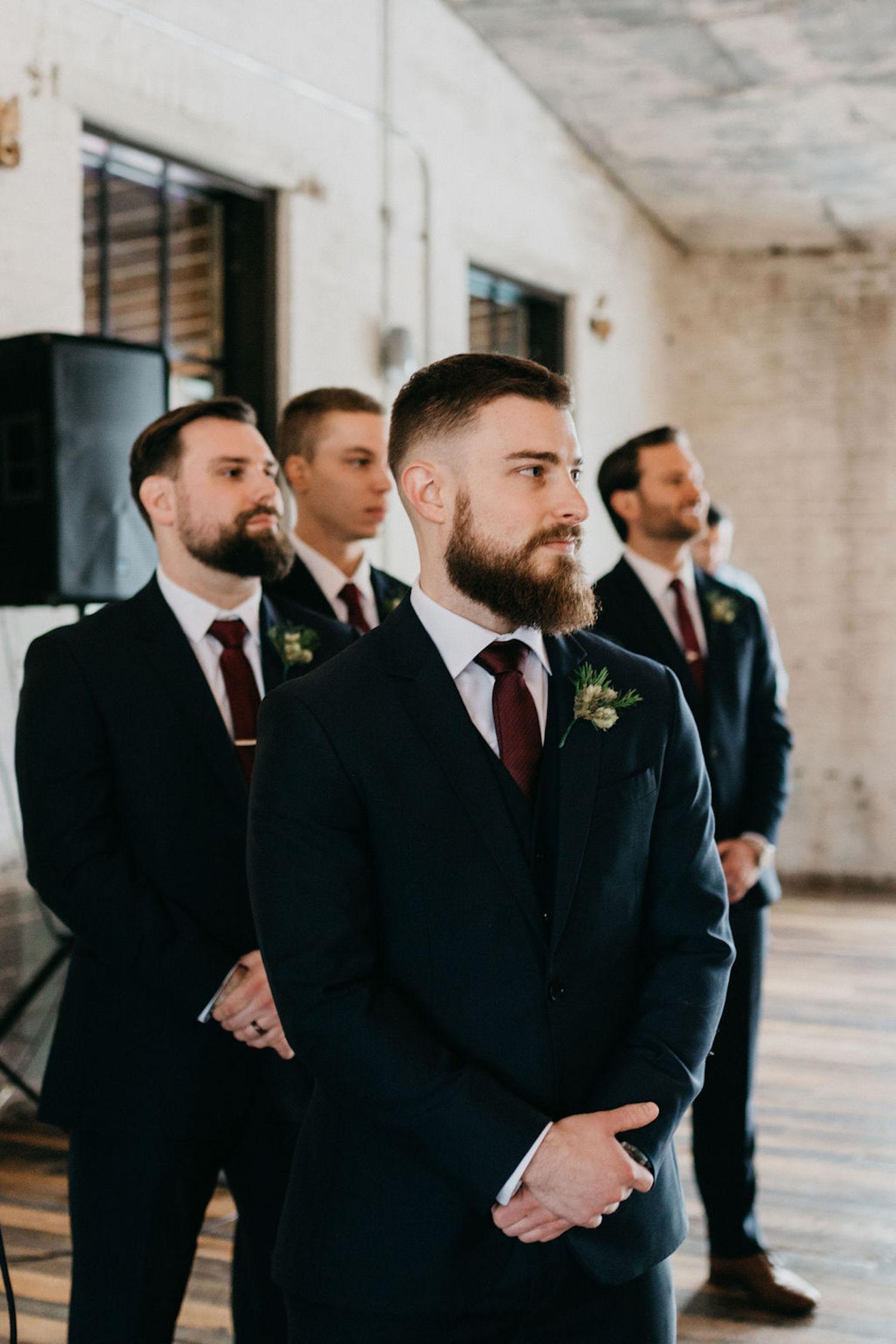 Groom standing with groomsman at Journeyman Distillery wedding