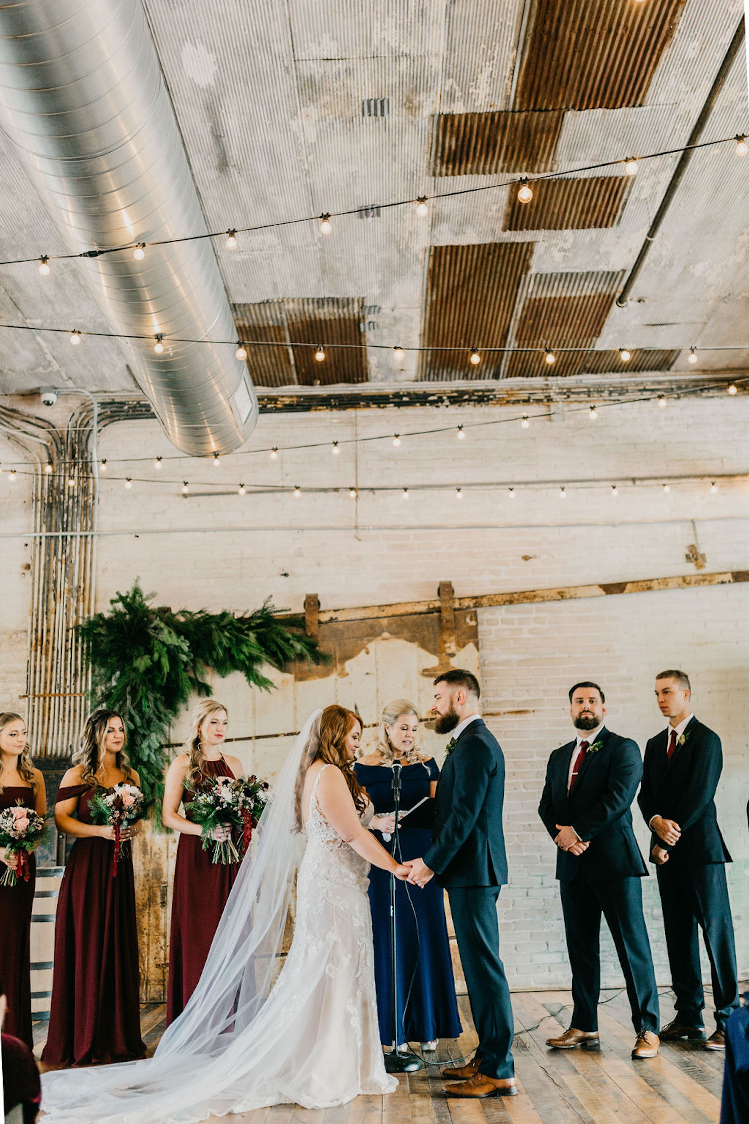 Bride and groom at alter of their Journeyman Distillery wedding