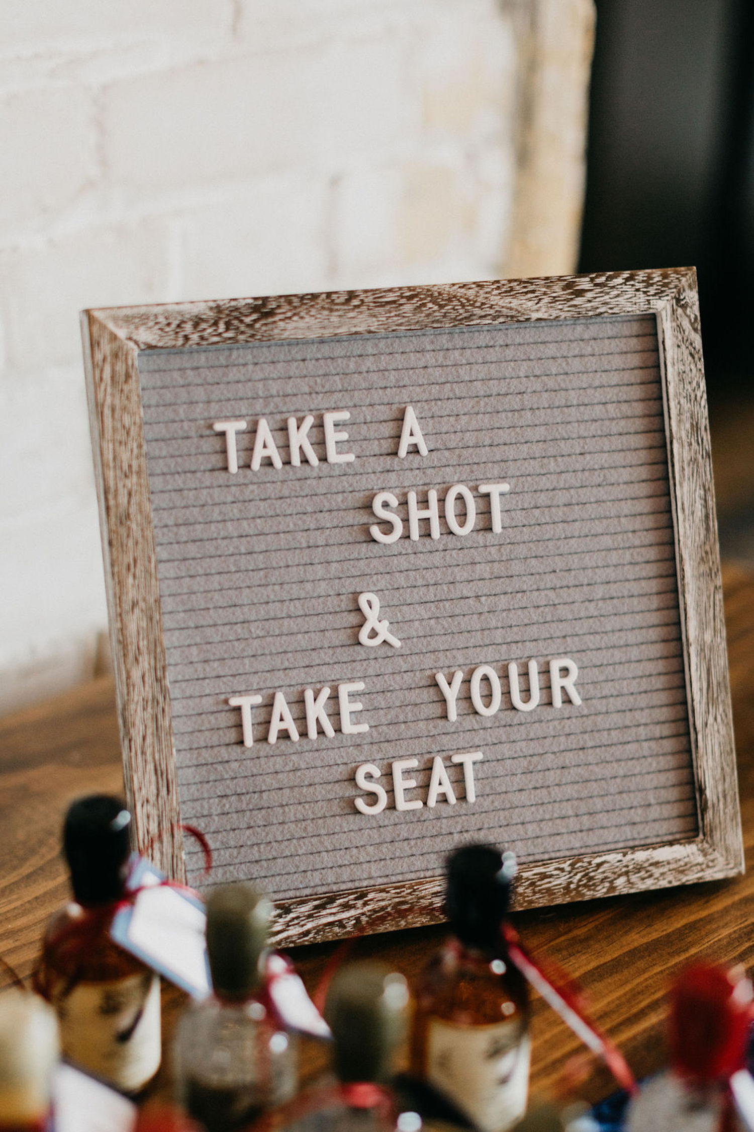Take your seat sign for Journeyman Distillery wedding