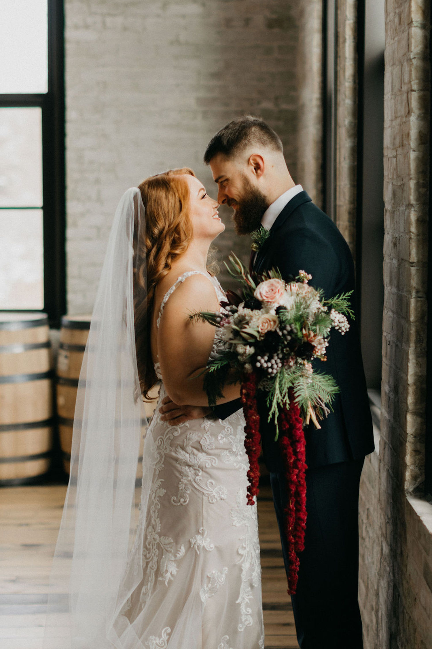 Bride and groom looking at each other at Journeyman Distillery wedding