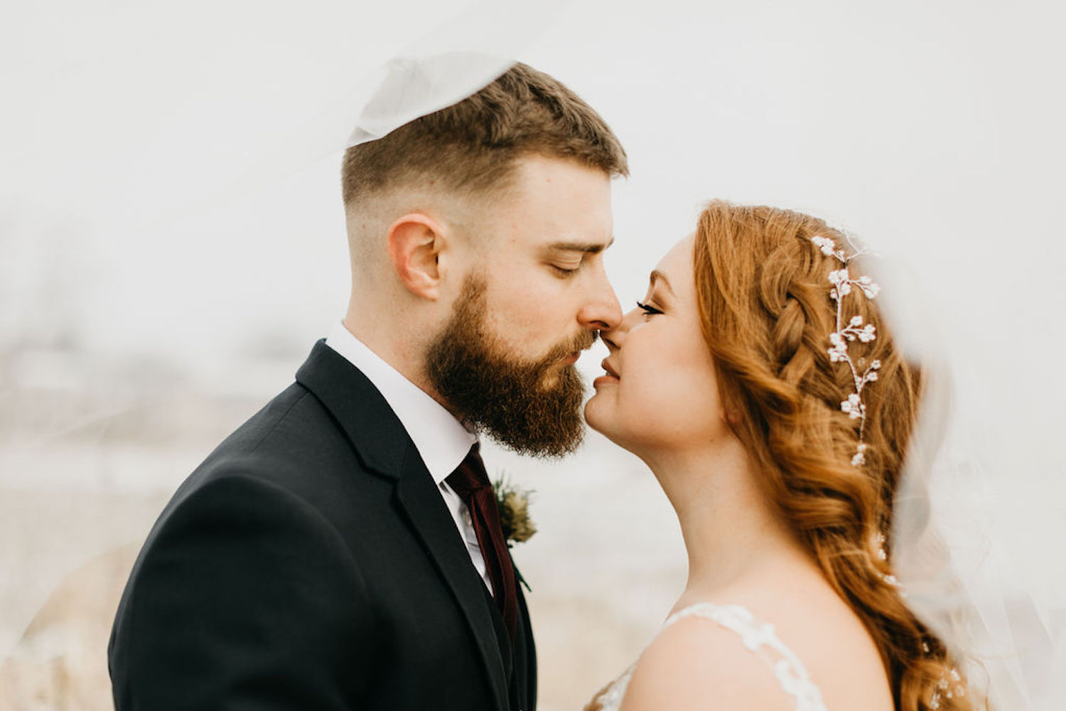 Bride and groom about to kiss at Journeyman Distillery wedding