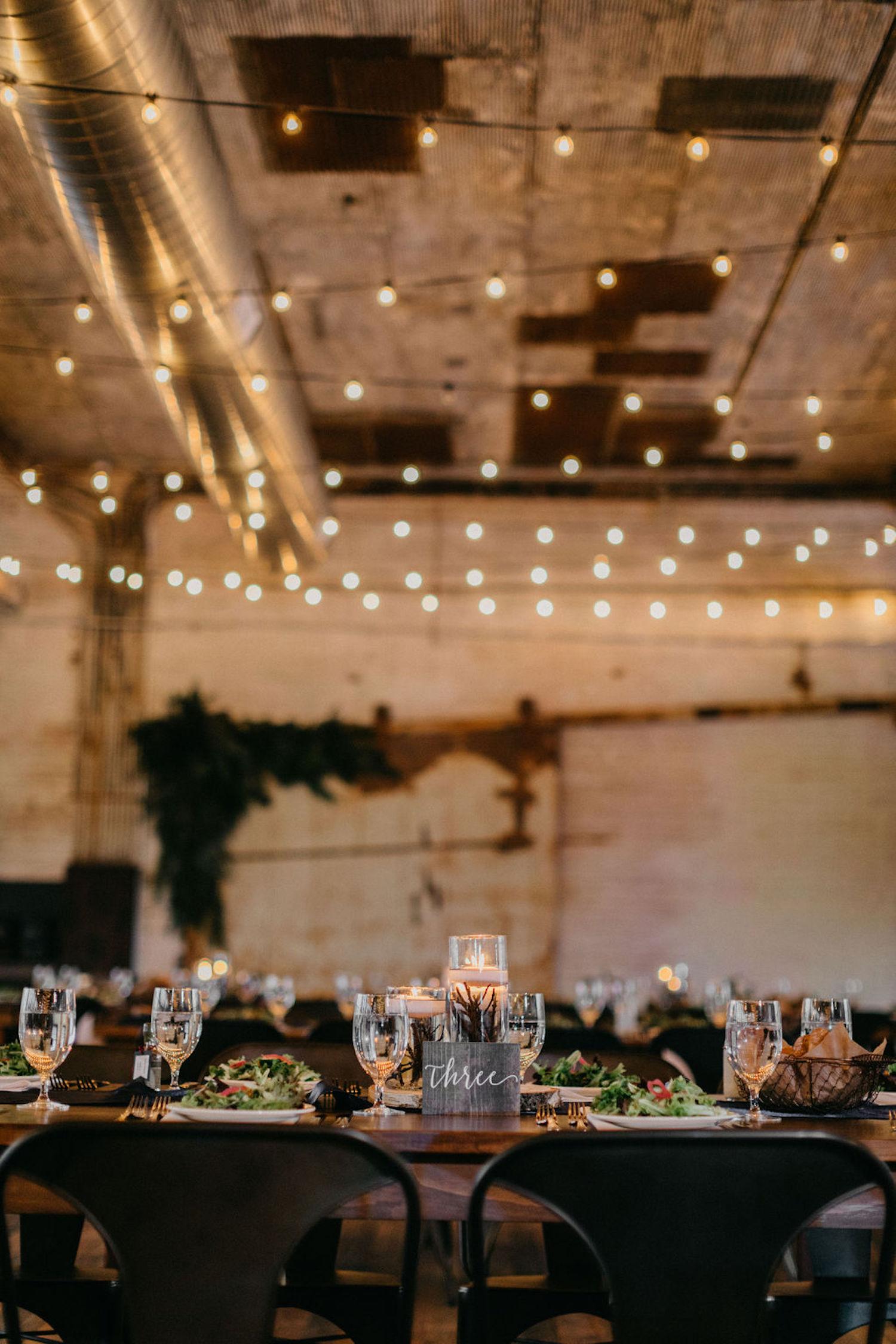 Lights over table of Journeyman Distillery wedding