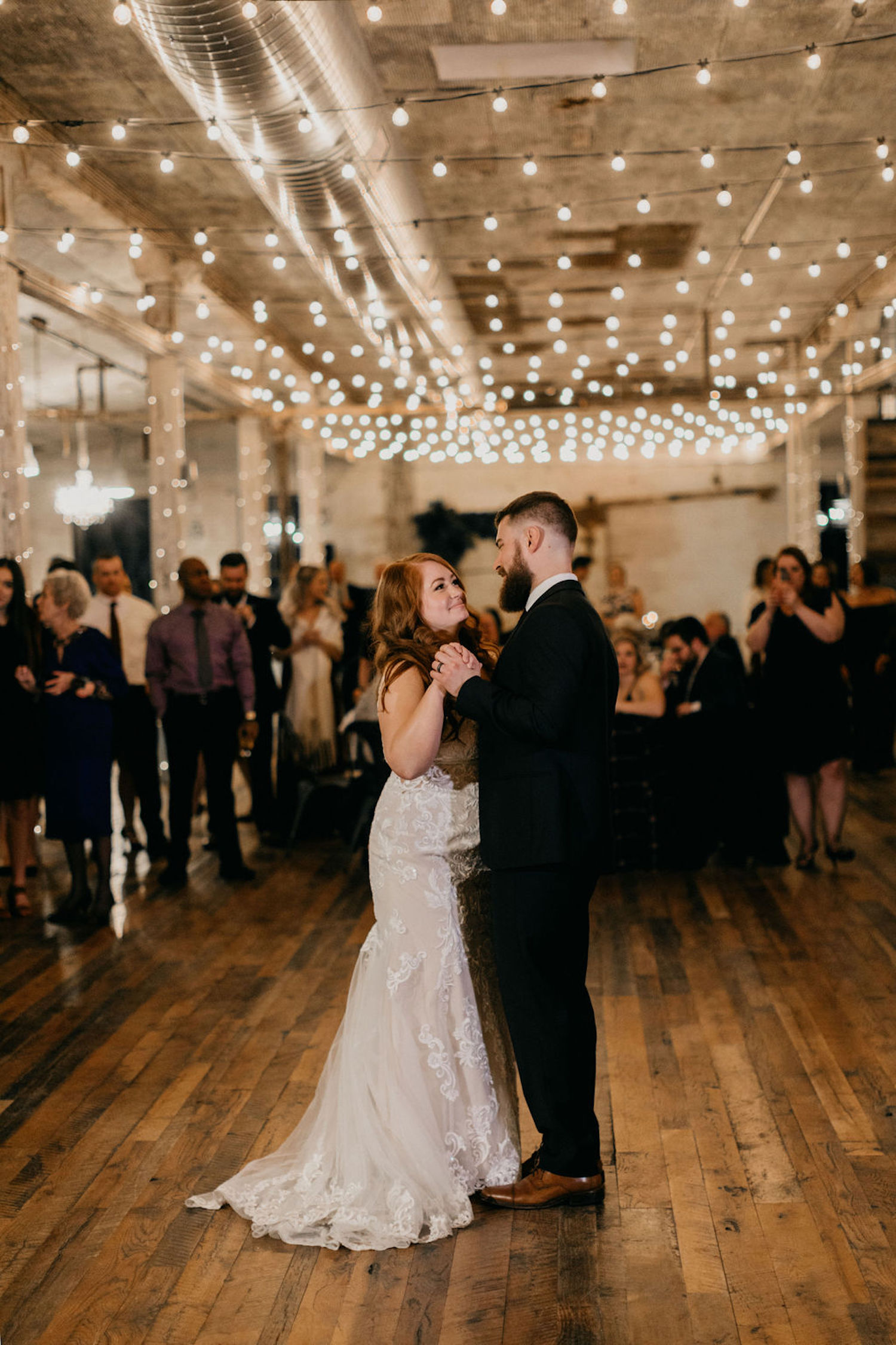 Bride and groom dancing together at their Journeyman Distillery wedding
