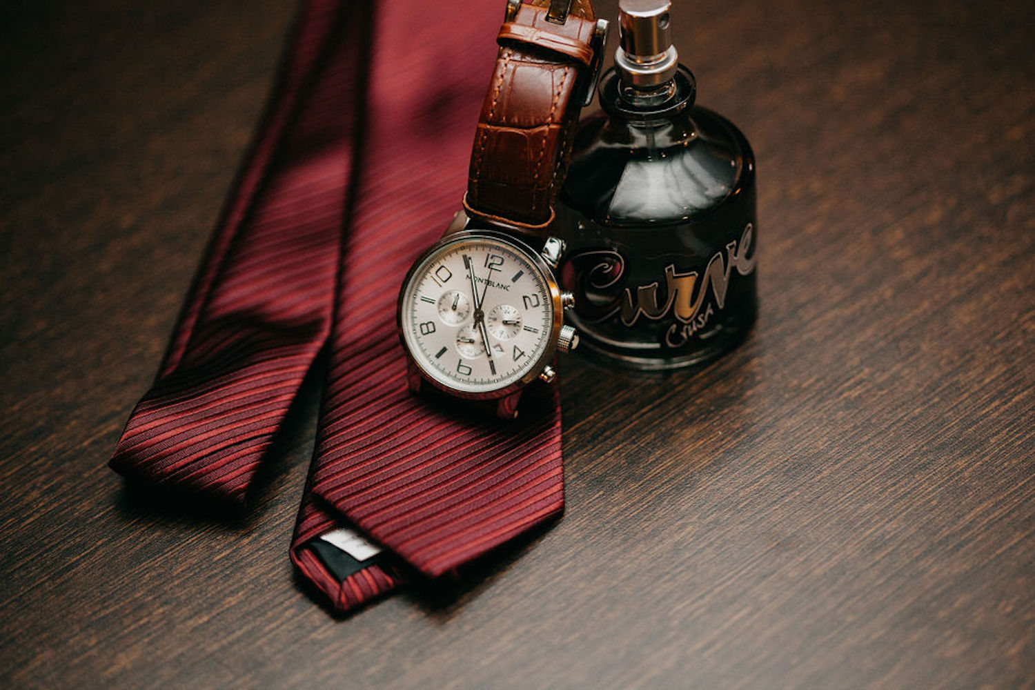 Grooms tie, watch and cologne