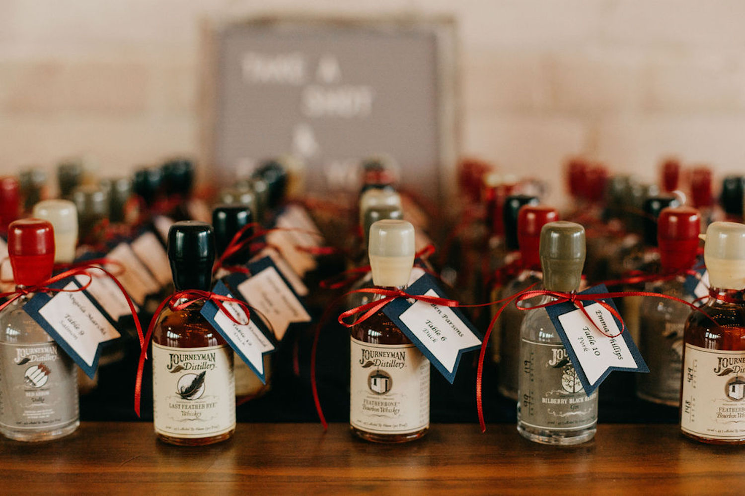 Shot bottles with name tags for Journeyman distillery wedding