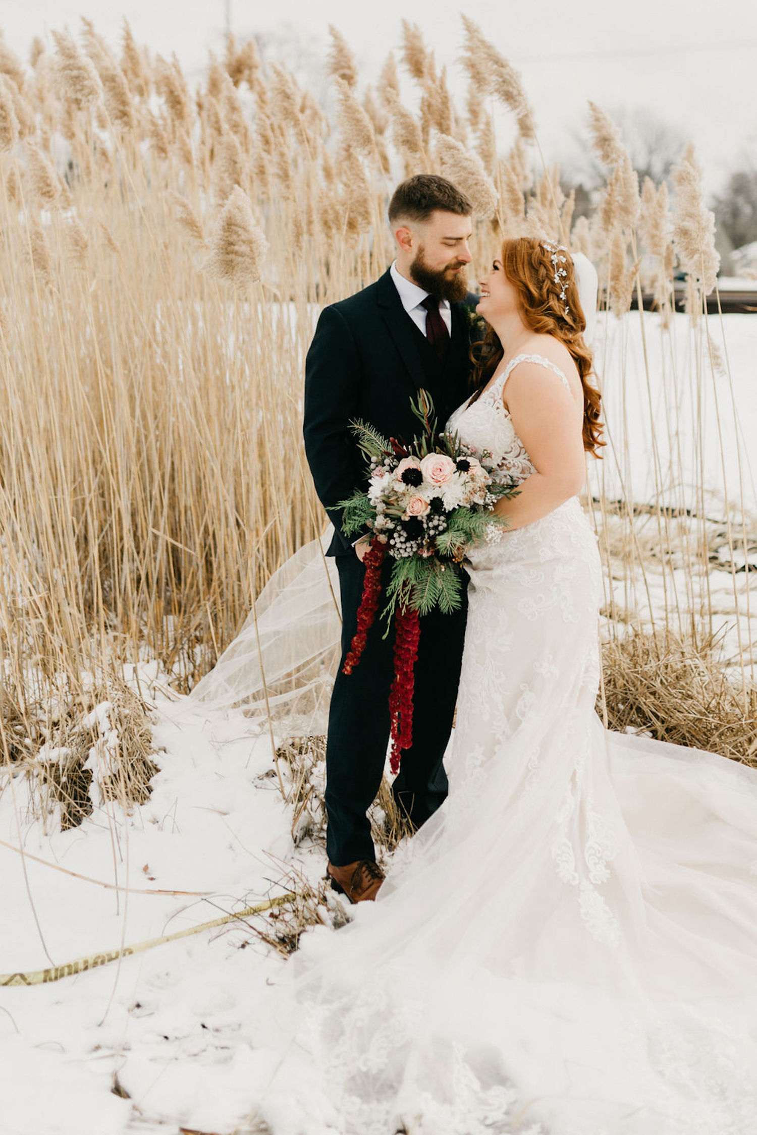Bride and groom smiling in the snow
