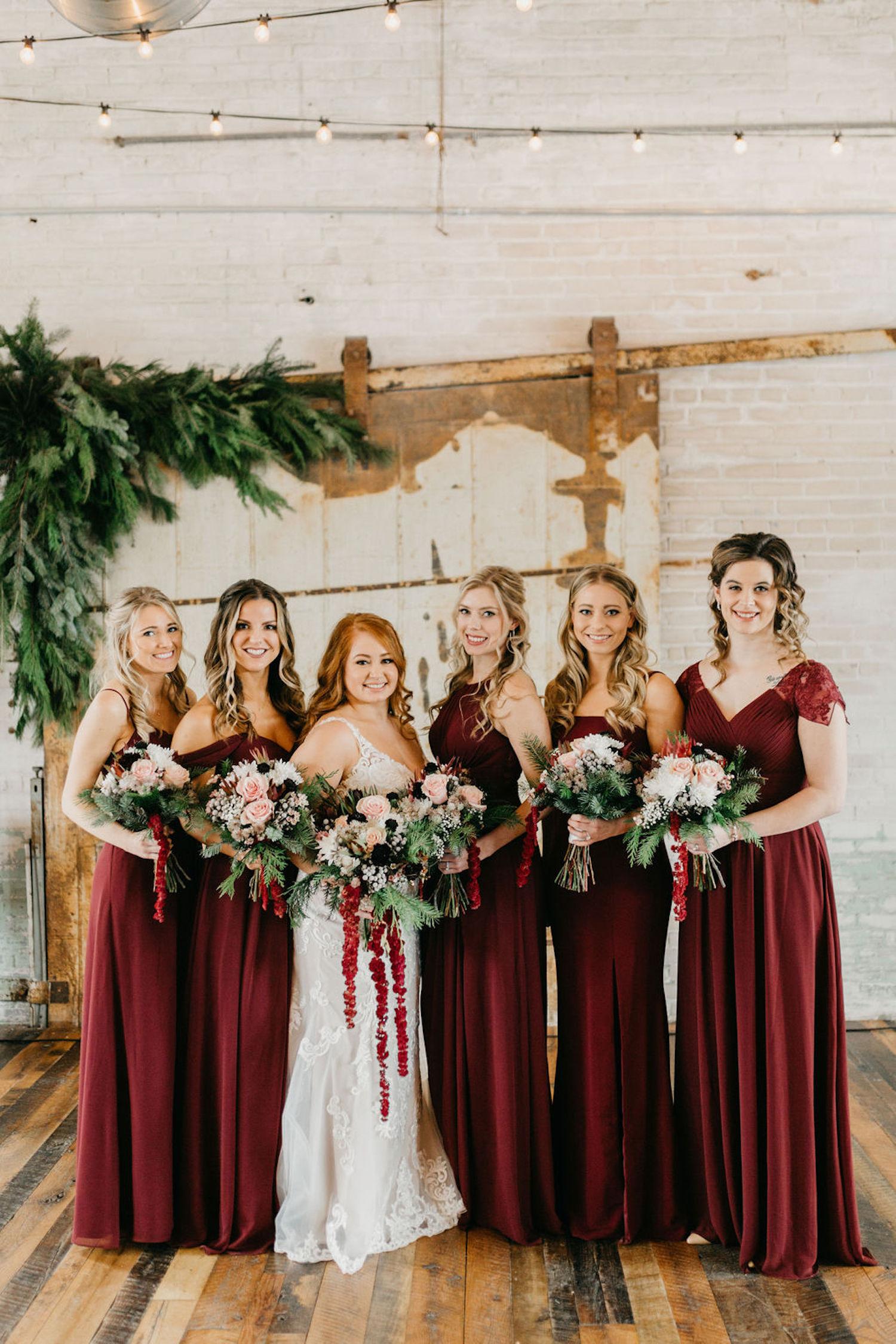 Bride and bridesmaids standing at Journeyman Distillery wedding
