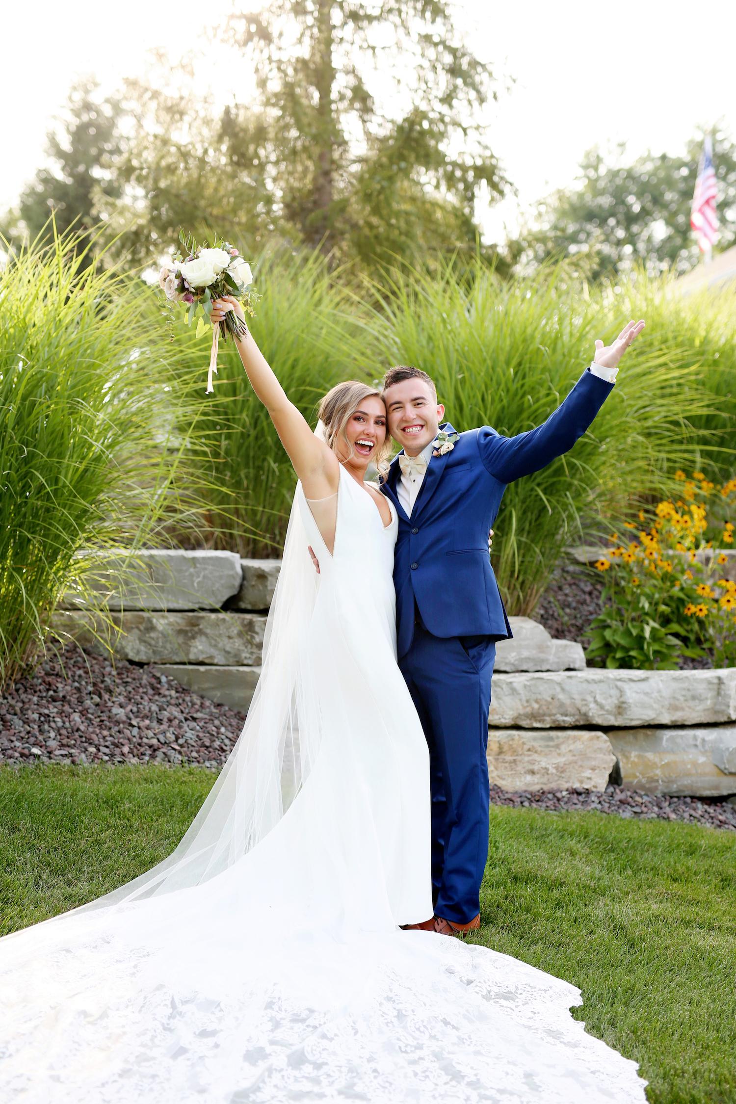 Bide and groom celebrating at kalamazoo Michigan wedding