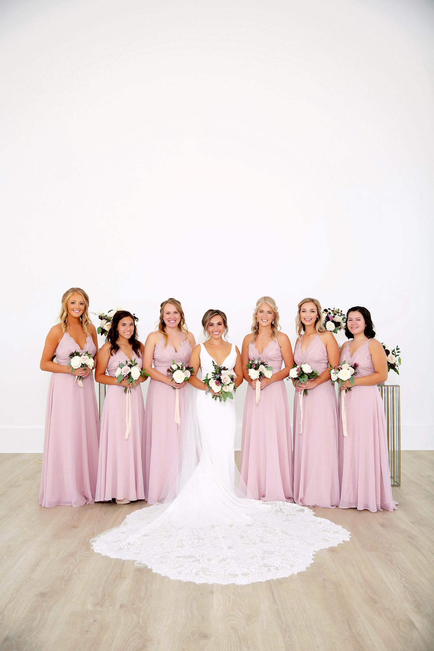 Bride standing with bridesmaids before kalamazoo michigan wedding