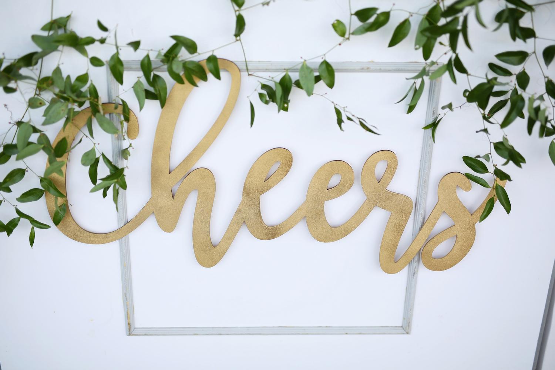 Cheers sign at kalamazoo michigan wedding