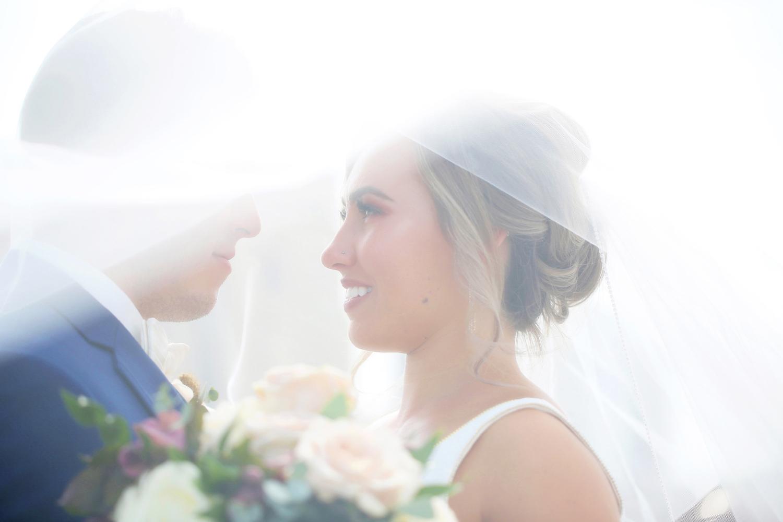 Bride gazing at groom at her Kalamazoo Michigan wedding