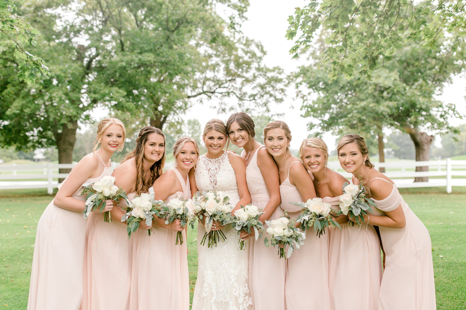 Bridesmaids standing with bride at Wallinwood Springs Golf Course wedding