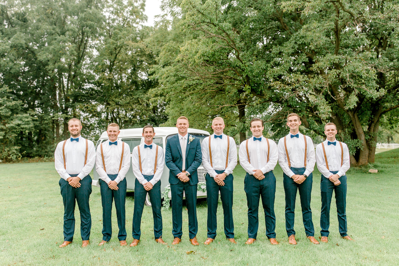 Groom and groomsman at Wallinwood Springs Golf Course wedding