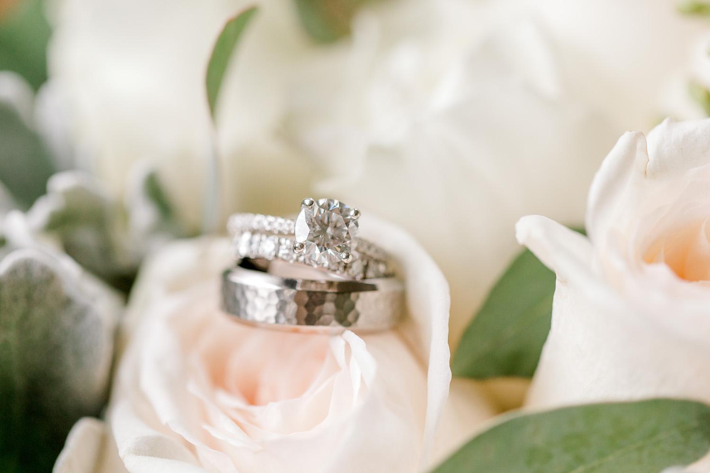 Wedding bands on rose
