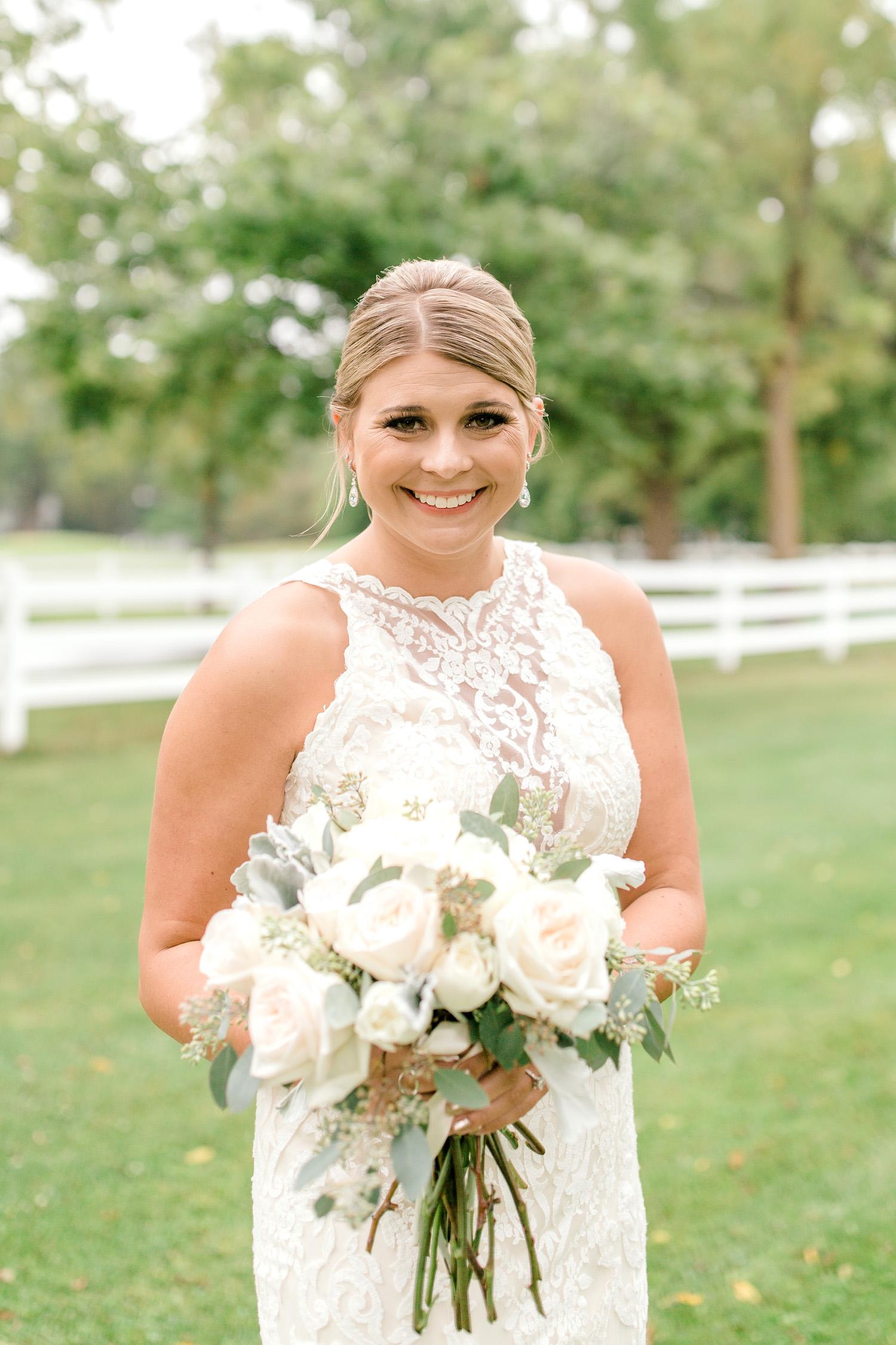 Bride smiling before Wallinwood Springs Golf Course wedding