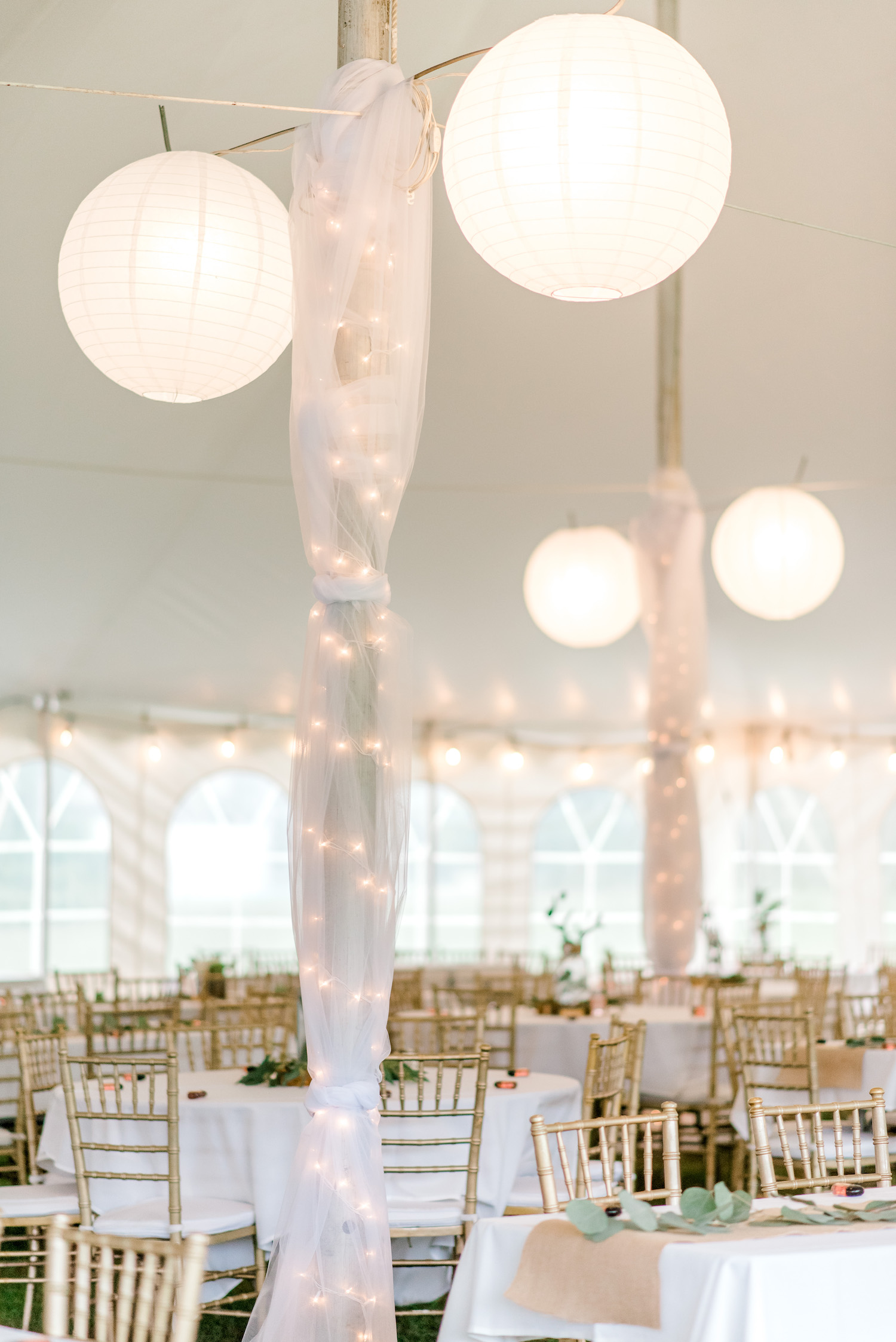 Decor under tent for Wallinwood Springs Golf Course wedding