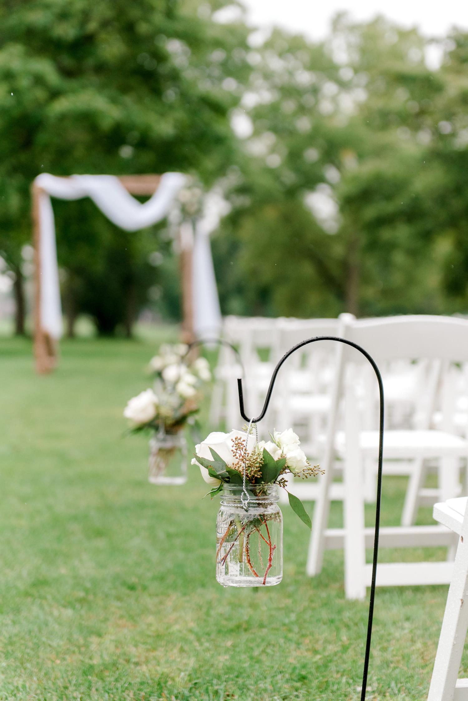 Flowers hanging on hooks along aisle