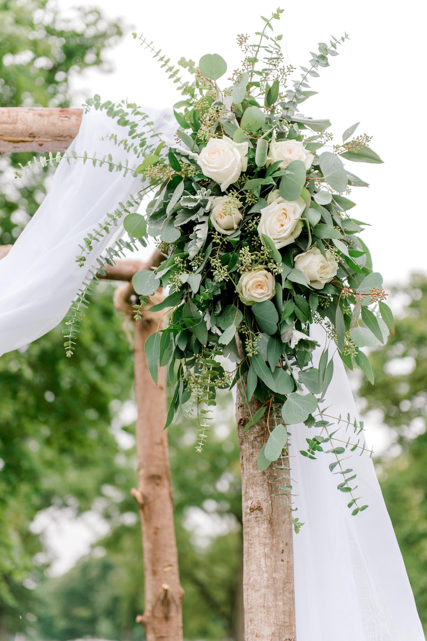 Floral arrangement on Wallinwood Springs Golf Course wedding arch