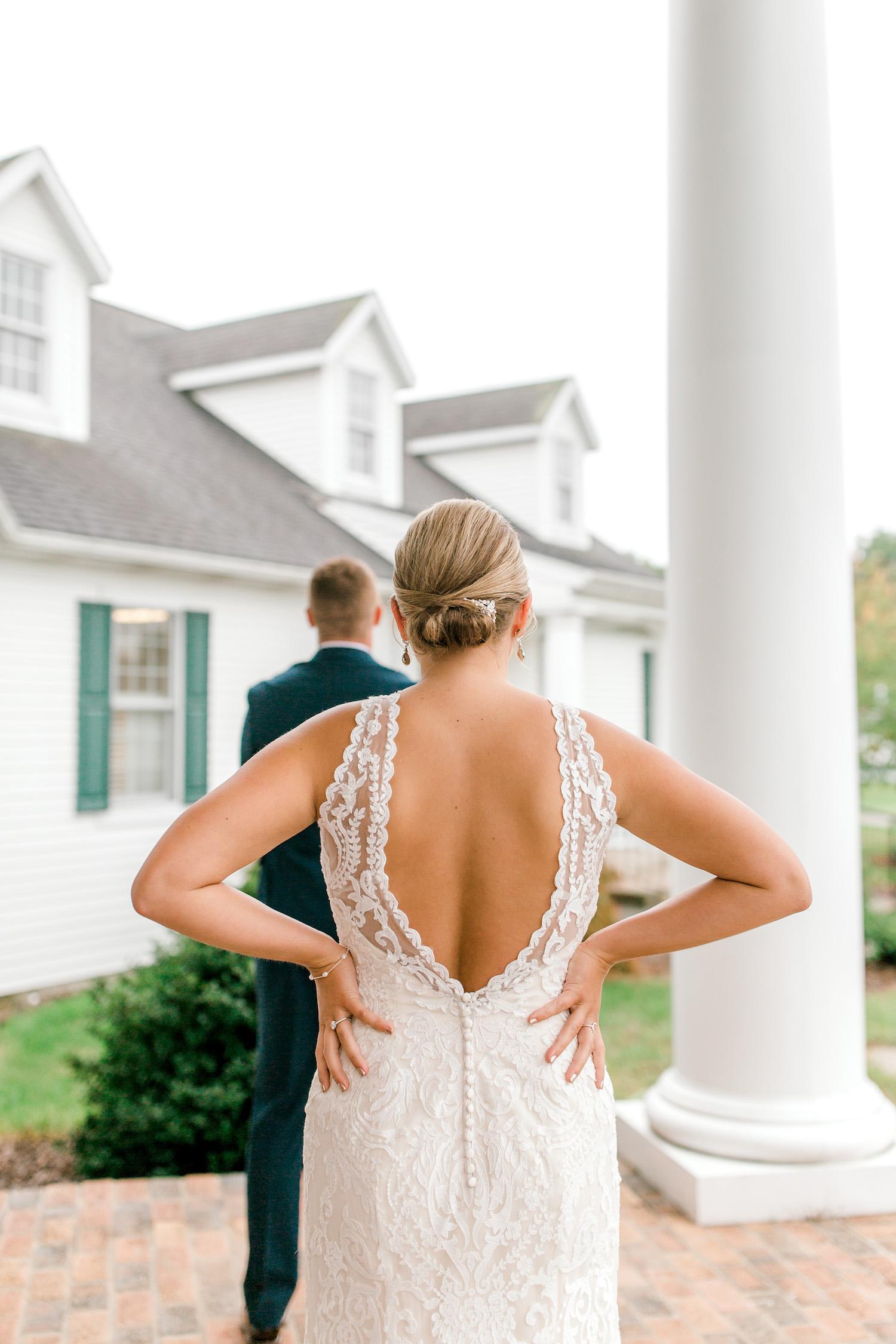 Bride standing behind her groom