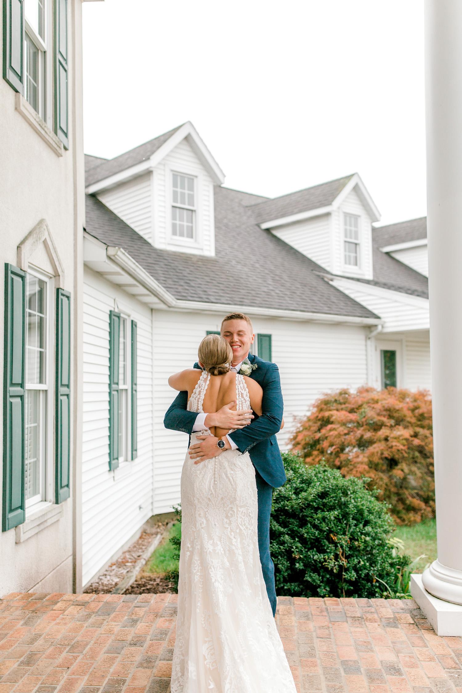 Bride and groom hugging before Wallinwood Springs Golf Course wedding