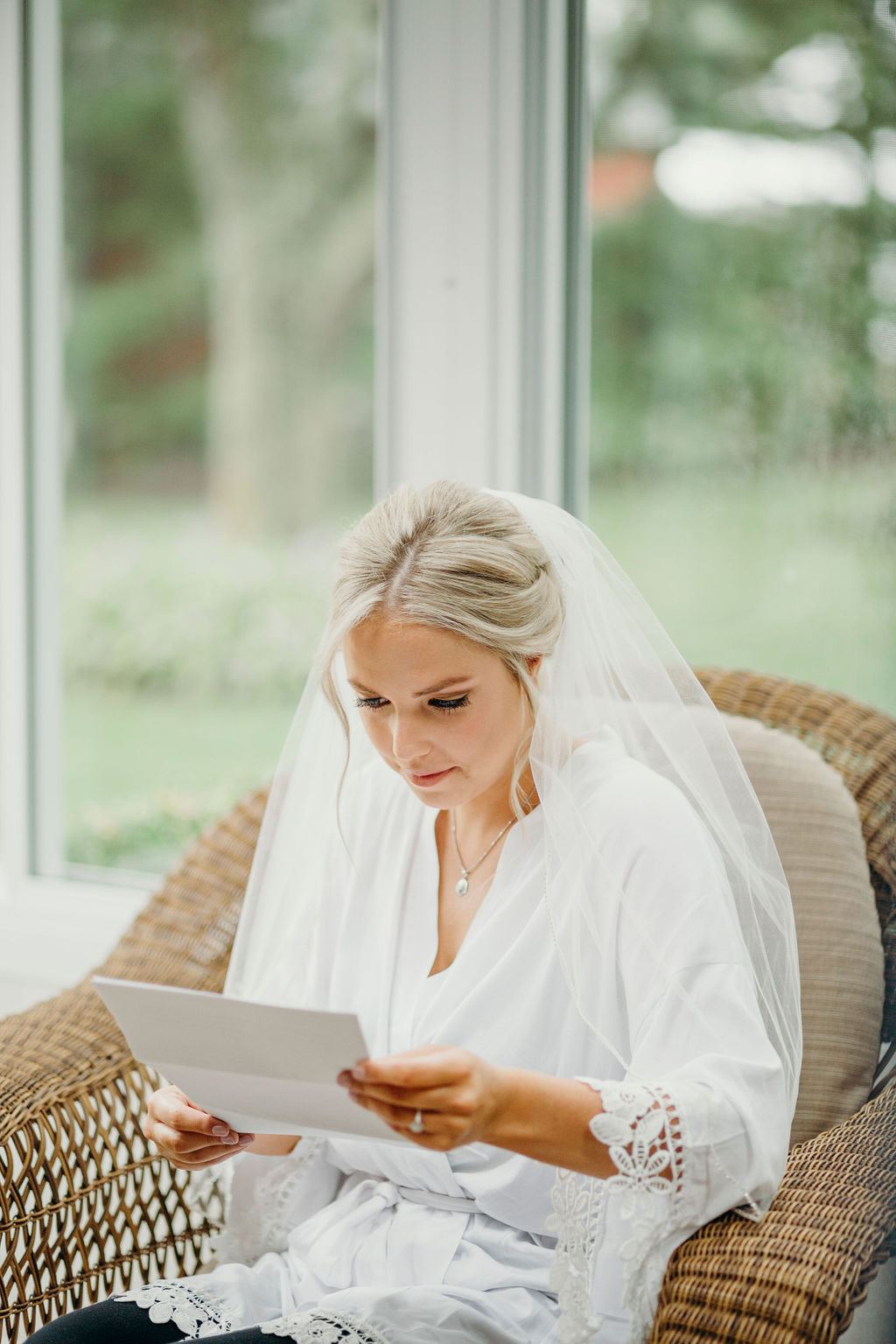 Bride reading letter before Frankfort, IL Wedding