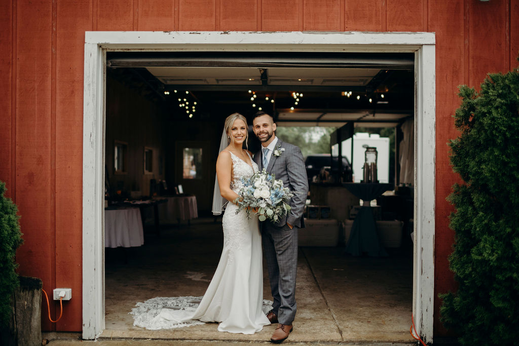 Bride and groom standing in front of barn of Frankfort, IL Wedding