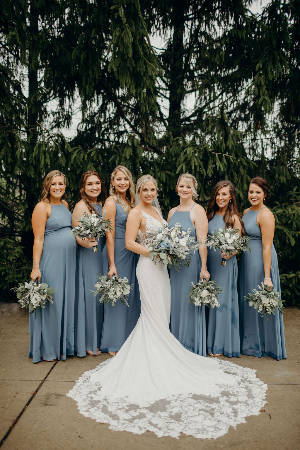 Bride standing with bridesmaids smiling