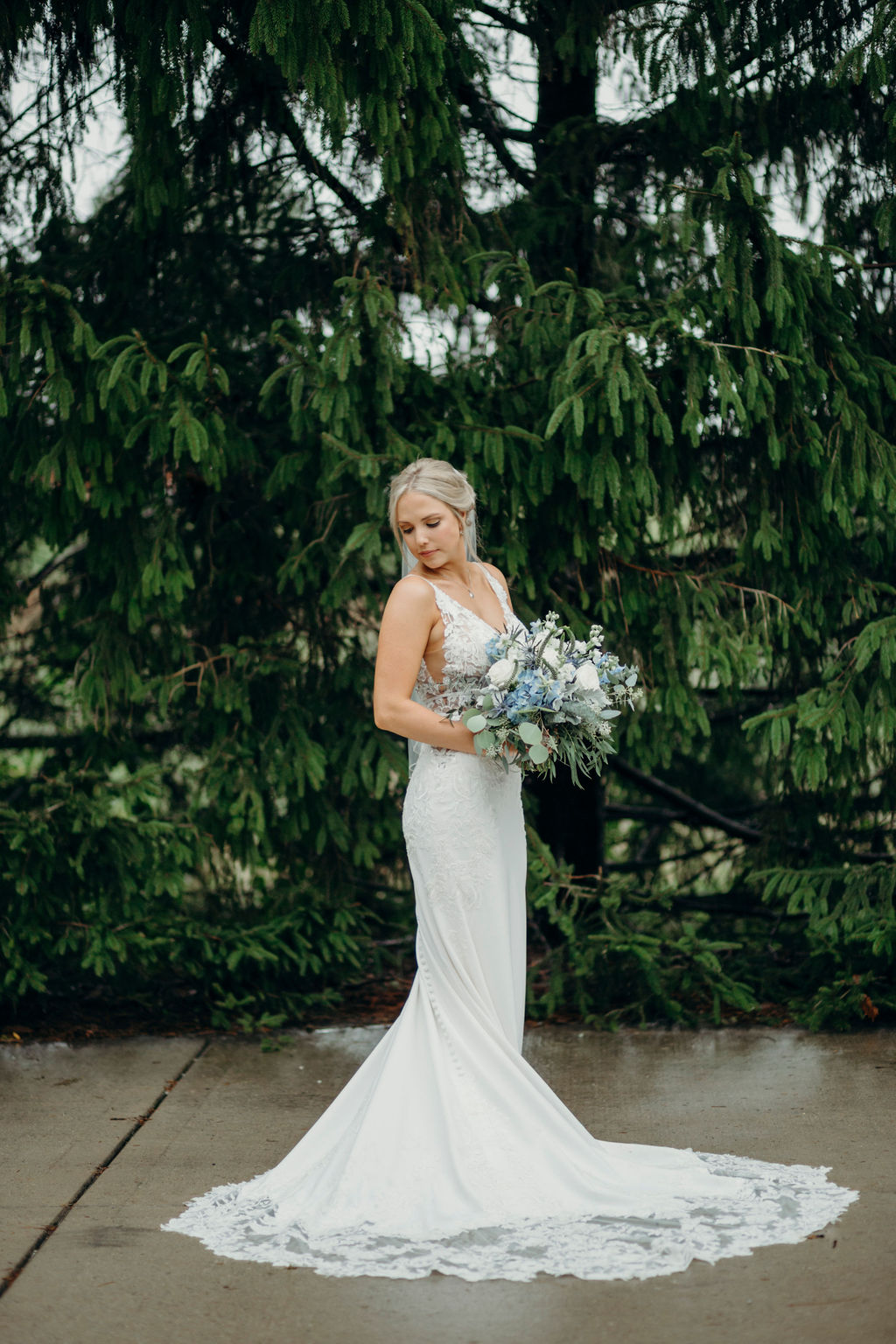 Bride standing with bouquet before Frankfort, IL Wedding