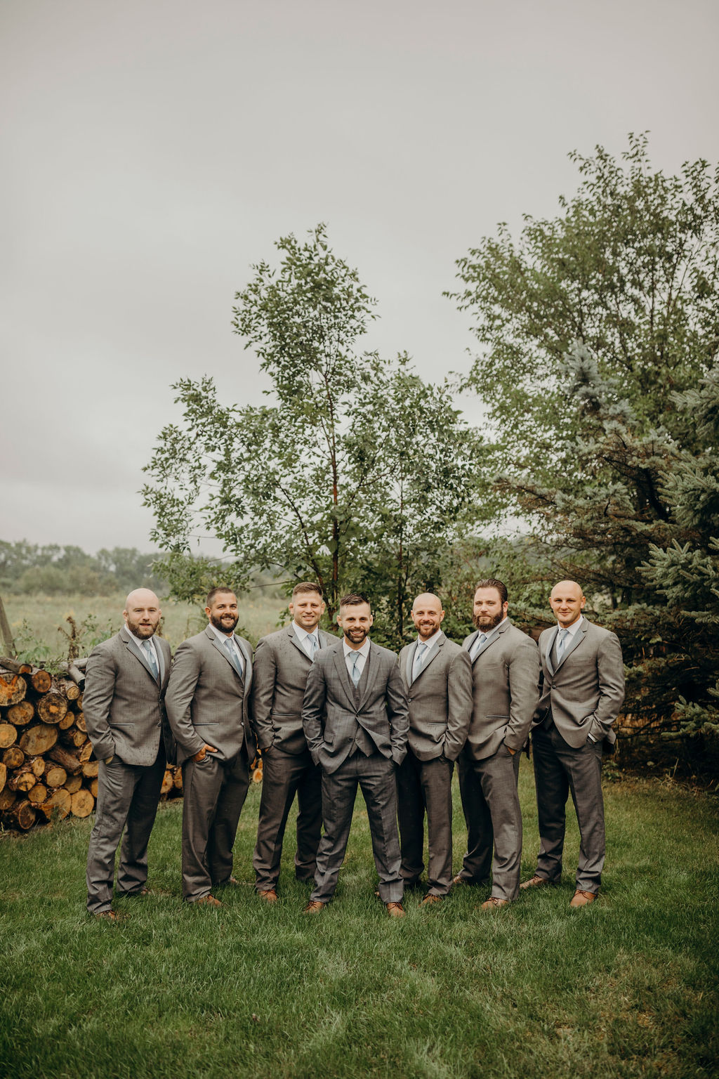 Groomsman standing in front of trees