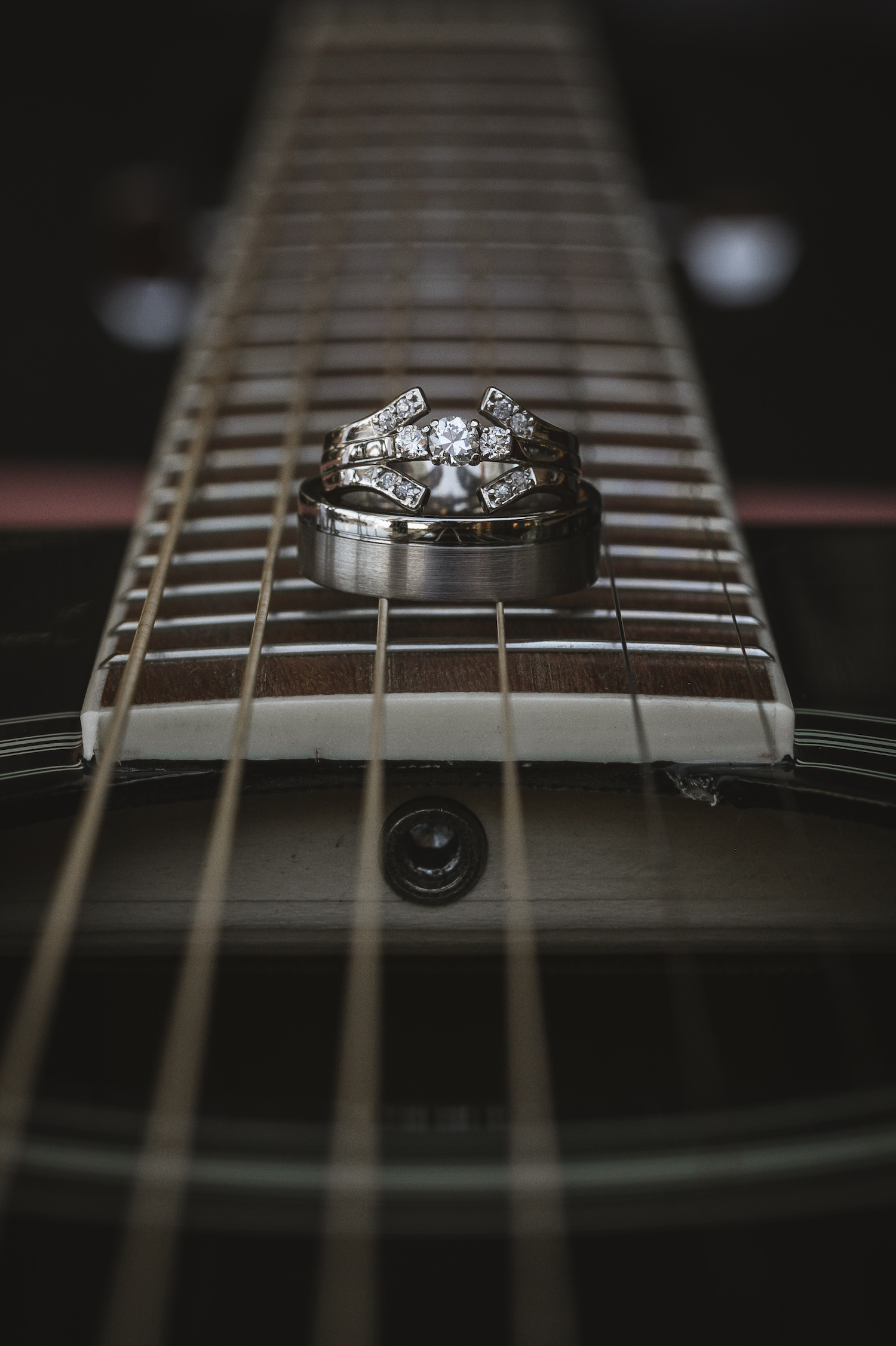 Rings laying on guitar strings