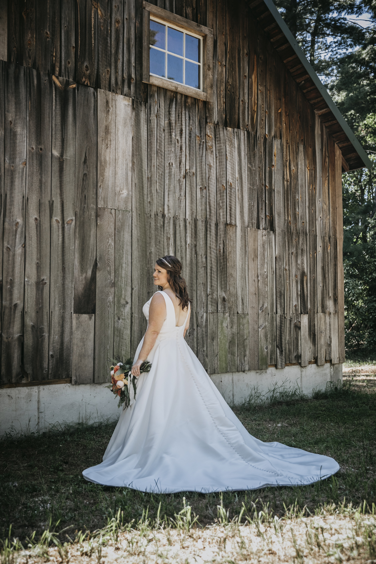 Bride standing by cabin at Higgins lake wedding