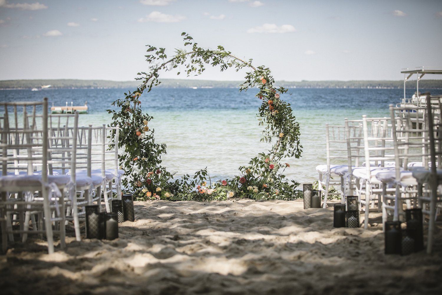 Ceremony lakeside with floral hoop
