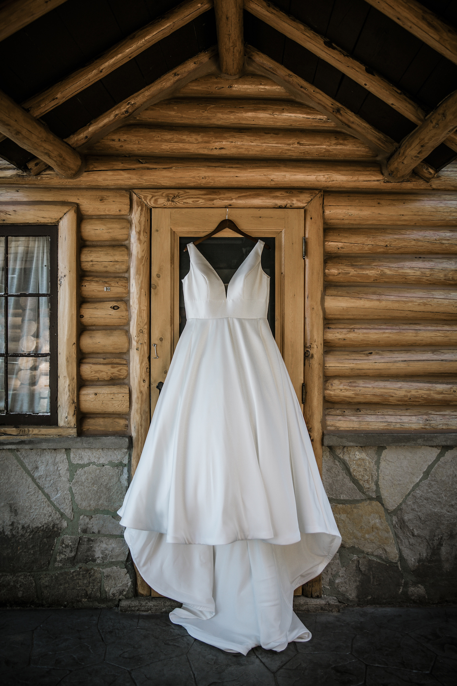 Bride's dress hanging on cabin door