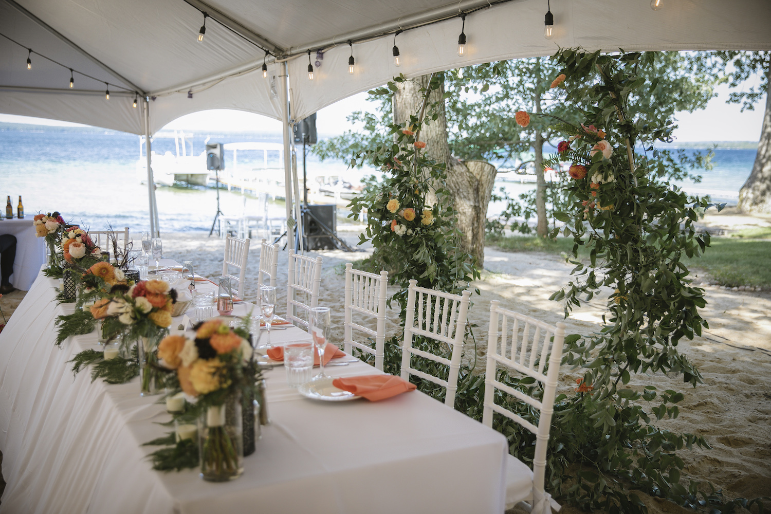 Head table with hoop floral arrangement