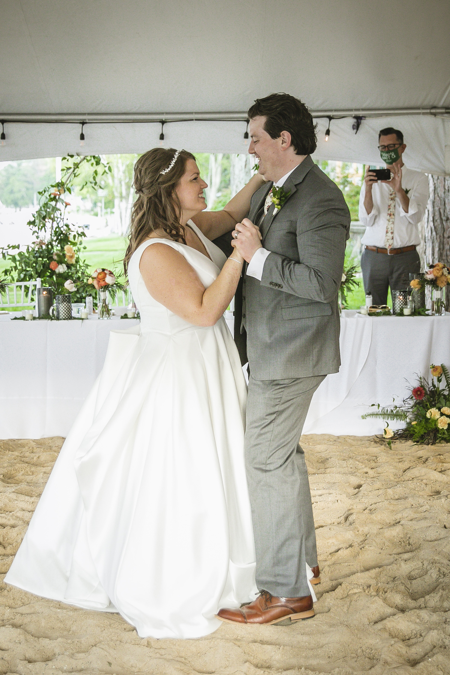 Bride and groom first dance at Higgins lake wedding