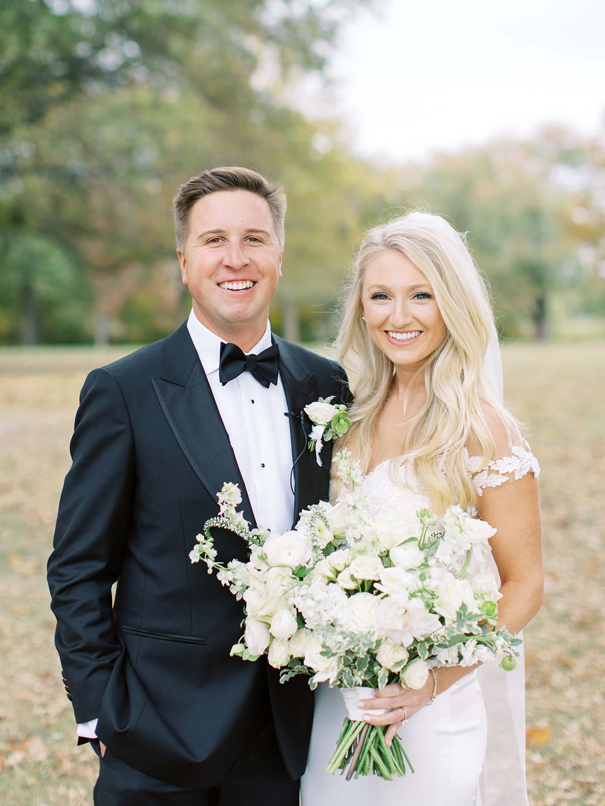 Bride and groom smiling together before Ritz Charles wedding