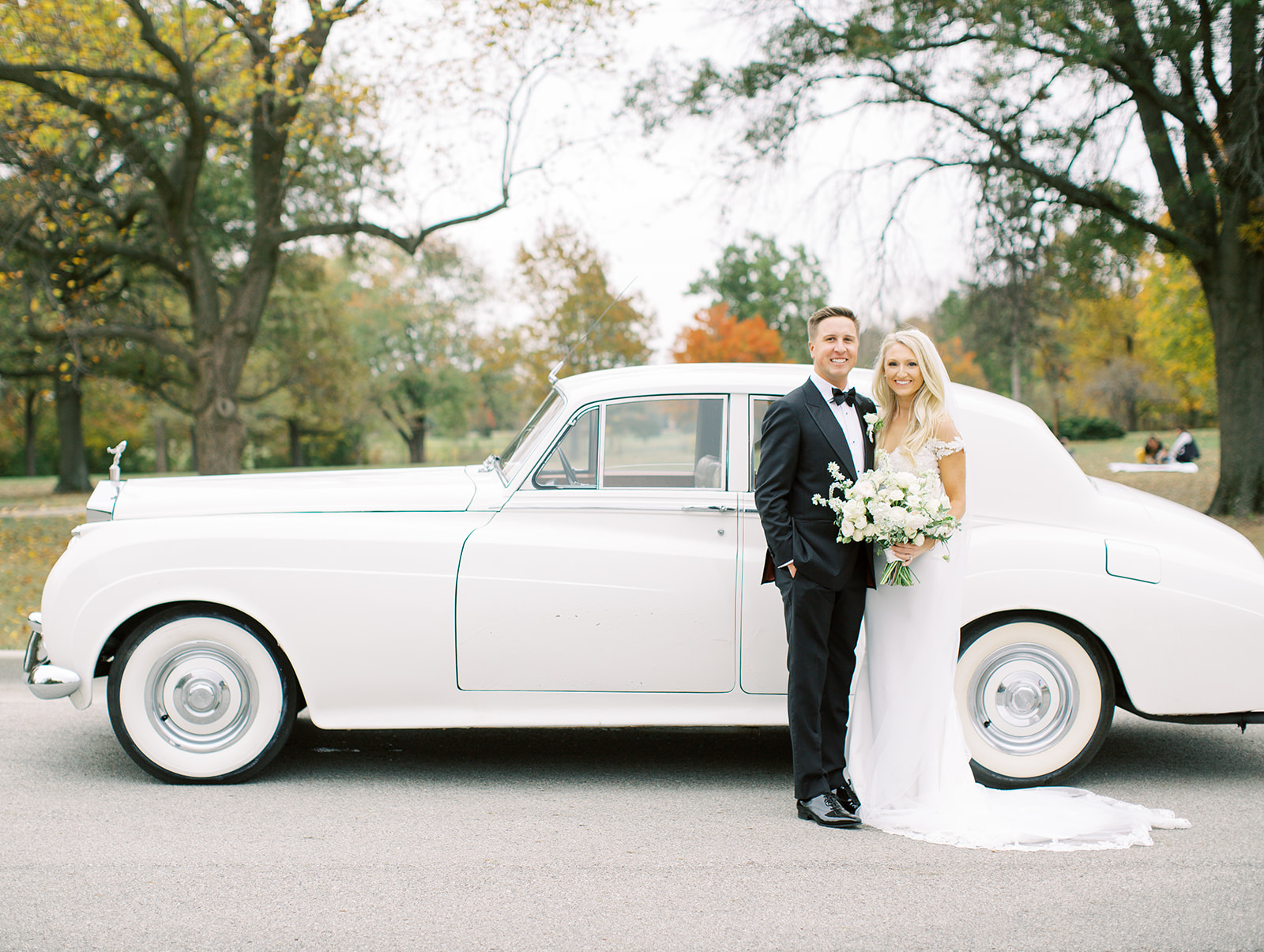 Bride and groom in front of classic car at Ritz Charles wedding
