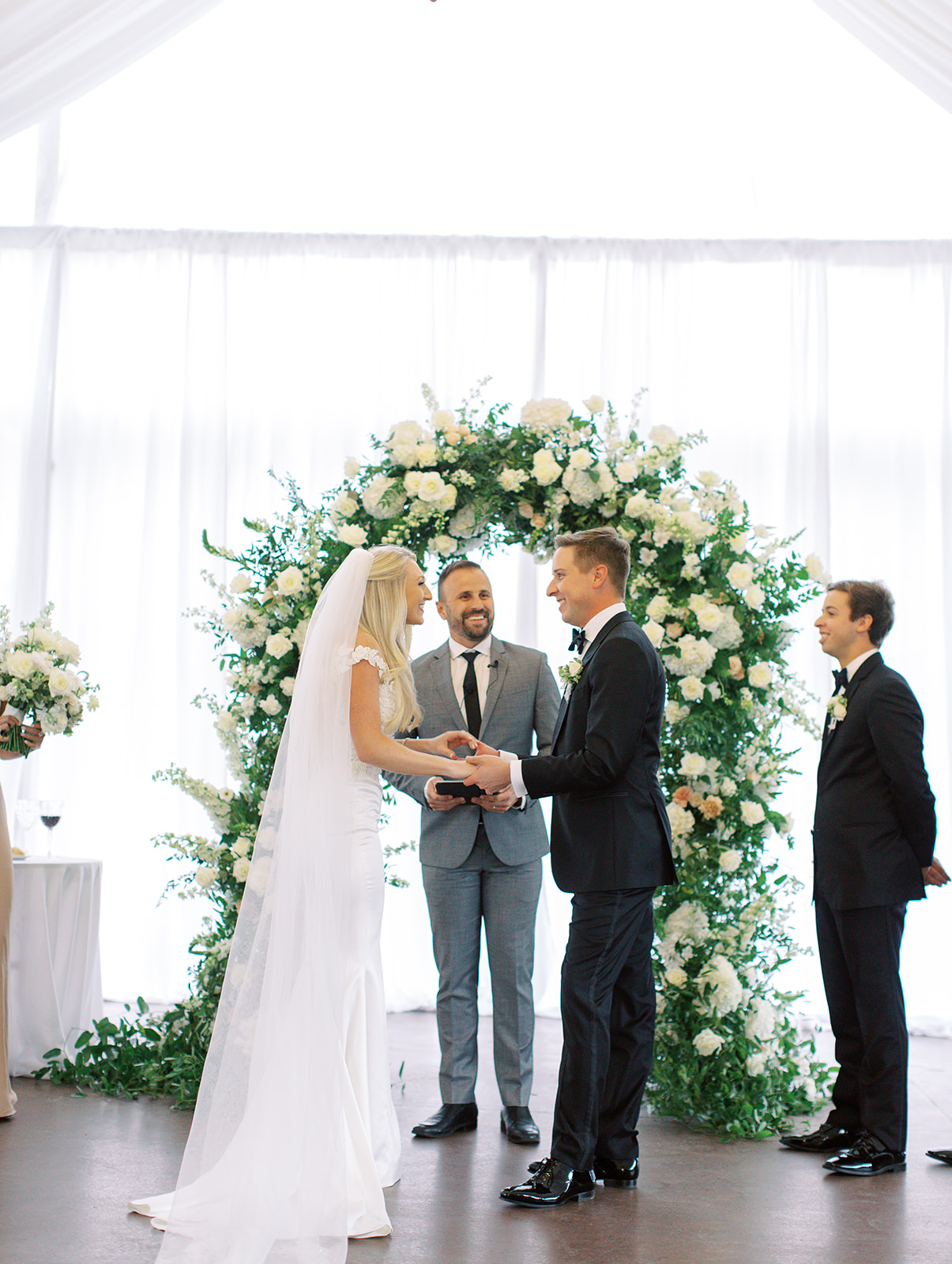 Bride and groom holding hands in front of alter