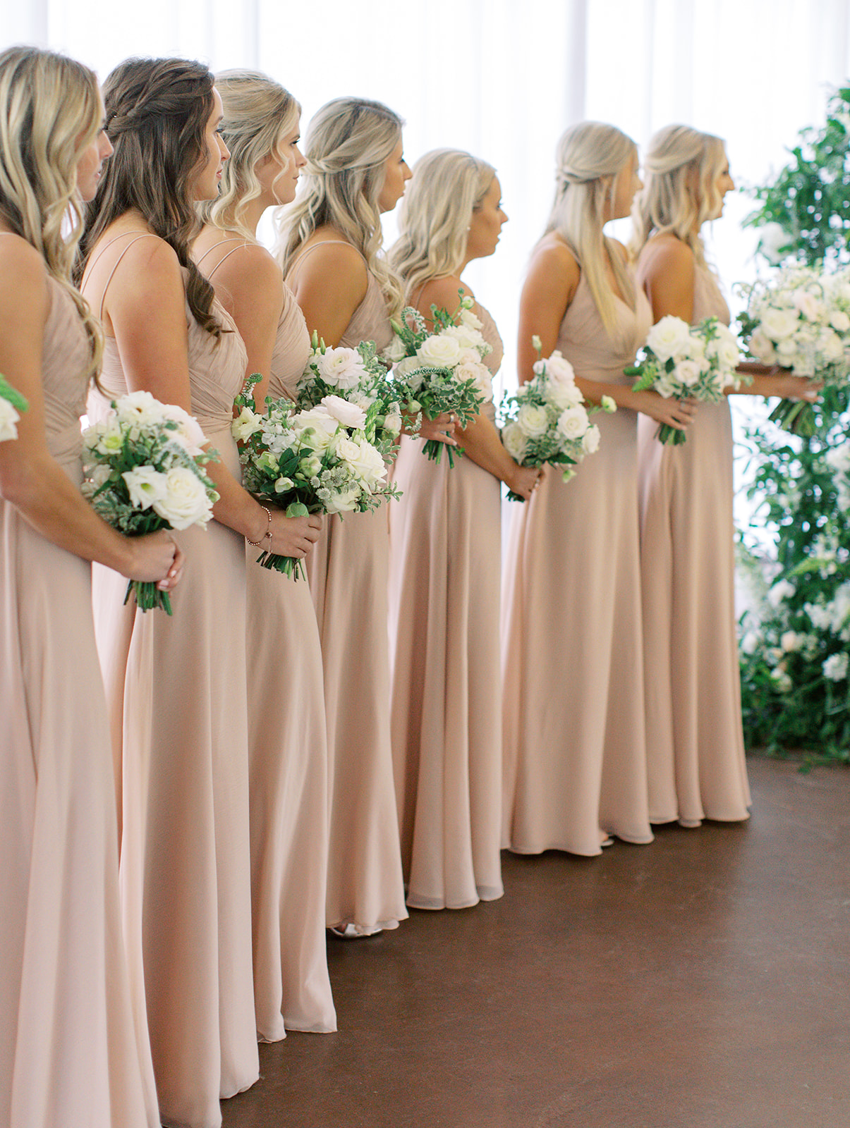 Bridesmaids holding bouquets at Ritz Charles wedding ceremony