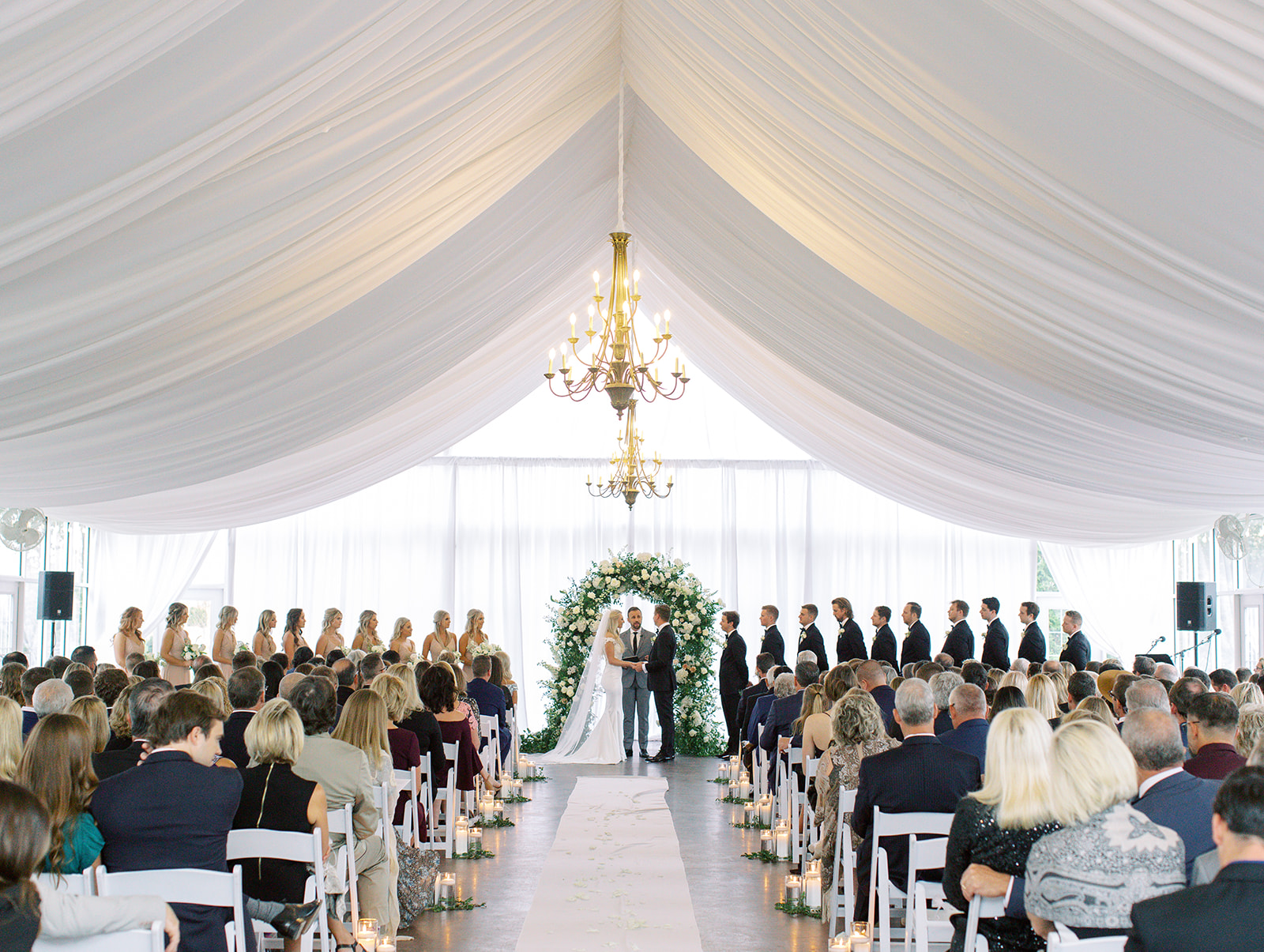 Bride and groom standing at alter of Ritz Charles wedding ceremony