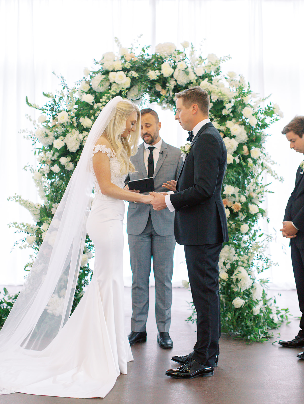 Bride and groom praying together at Ritz Charles wedding ceremony