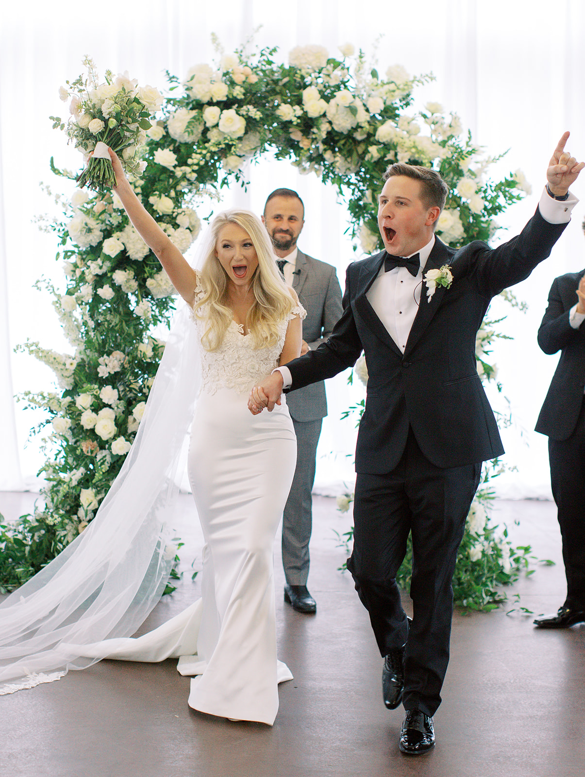 """Bride and groom cheering after saying """"I do"""""""