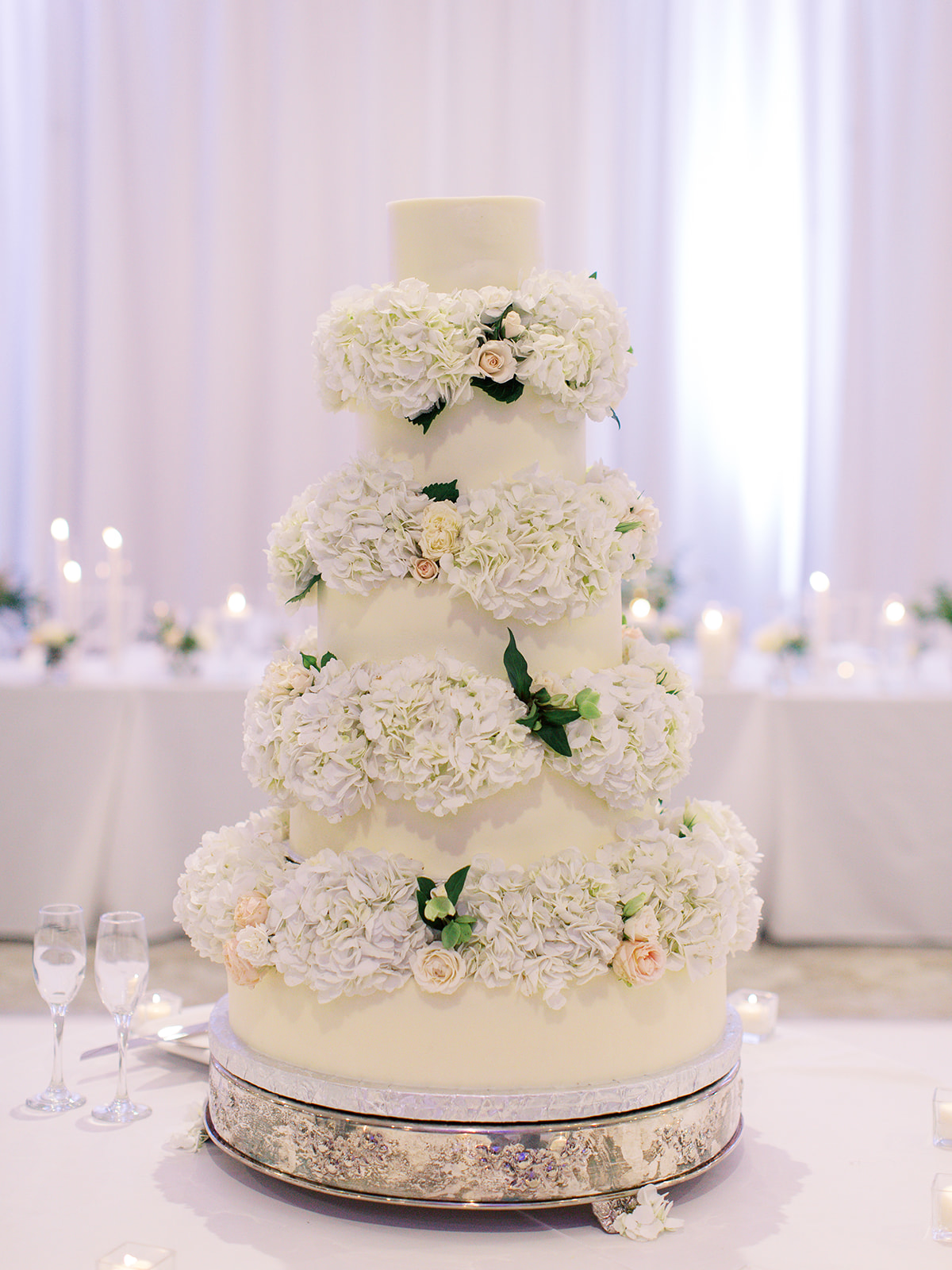 Ritz Charles wedding cake with floral decor
