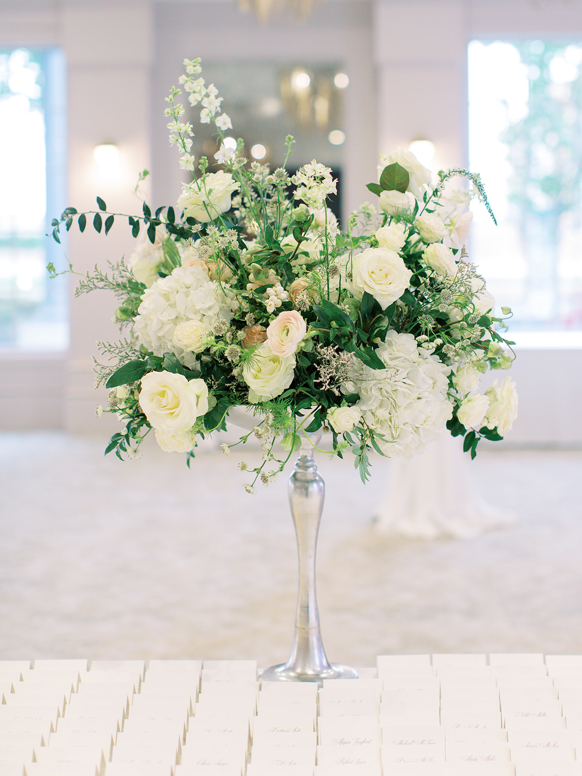 Name card display with floral bouquet