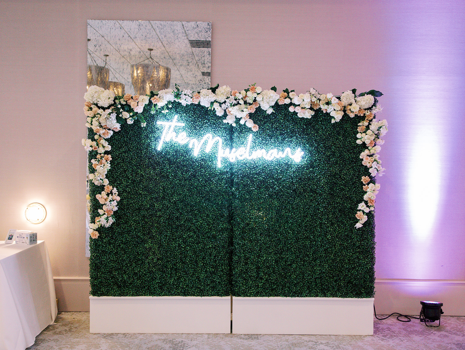 Ritz Charles wedding neon sign and floral background