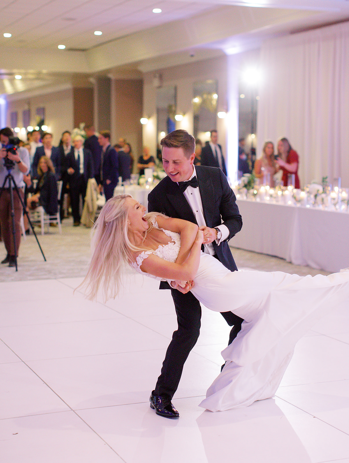 Groom dipping his bride during first dance of Ritz Charles wedding